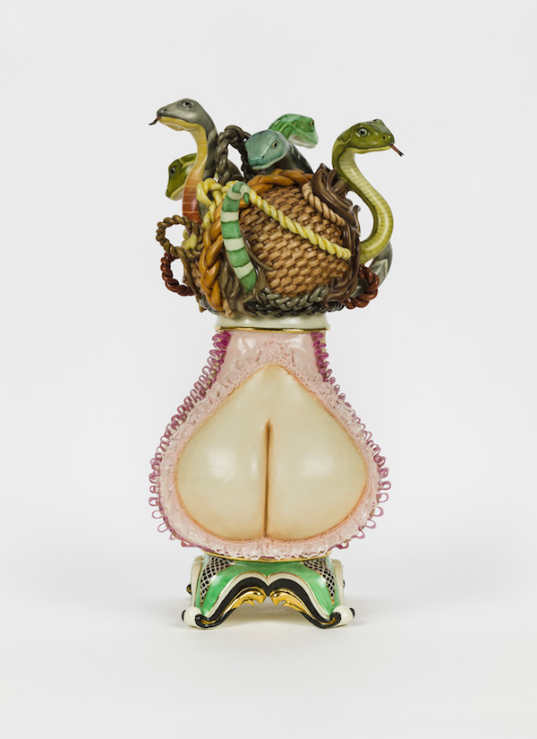 Vase-shaped sculpture showing buttocks-shaped bottom with intertwined snacks around rope at top